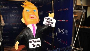 A piñata of presidential candidate Donald Trump hangs in a booth at the 2015 ALEC conference. Photo by Chris Stone