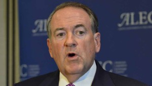 GOP presidential candidate Mike Huckabee speaks to press at ALEC convention. Photo by Chris Stone