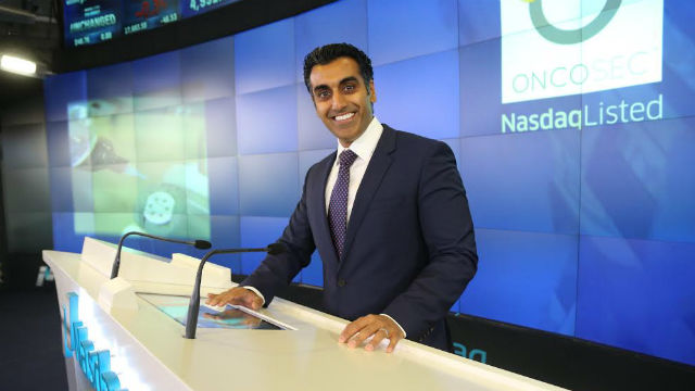 Punit Dhillon, president and chief executive officer of OncoSec Medical, rings the NASDAQ opening bell.
