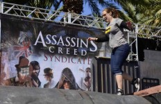 """A girl finishes an """"Assassins Creed"""" obstacle course across the street from the Convention Center. Chris Stone photo"""