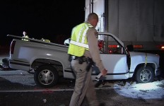A California Highway Patrol officer walks by the damaged pickup truck. Courtesy OnScene.TV