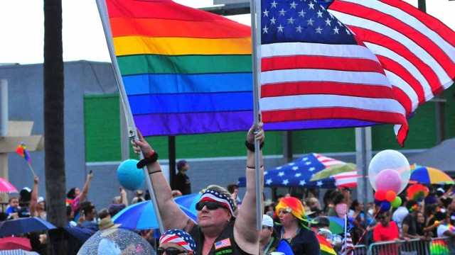 Motorcycle riders lead the parade with the rainbow and American flags. Chris Stone photo