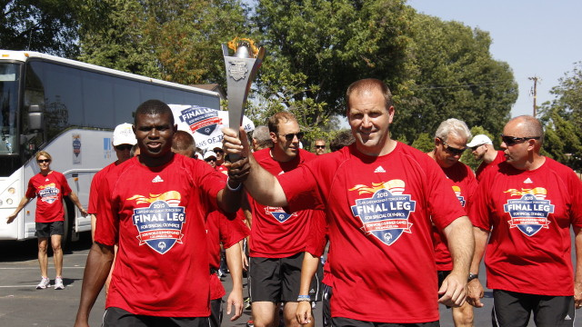 The Special Olympics torch is carried in Simi Valley on Friday. Photo by Dave Kramer