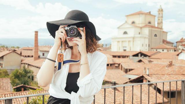 A tourist taking a snapshot overseas. Photo via Pixabay