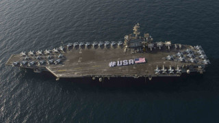 Sailors aboard the USS Theodore Roosevelt in the Arabian Gulf spell out #USA with the American flag on the flight deck for Independence Day weekend. Navy Photo
