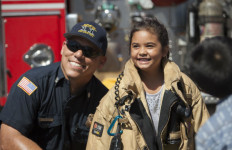 A San Diego firefighter with a youth from the Southcrest neighborhood. Courtesy One San Diego