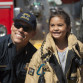 A San Diego firefighter with a youth from the Southcrest neighborhood at an earlier block party. Courtesy One San Diego