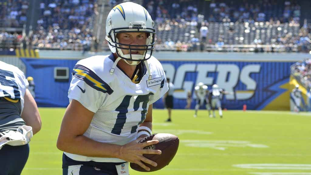 Charger quarterback Philip Rivers practices handoffs during warmup. Photo by Chris Stone