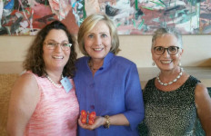 Hillary Clinton with Shari Schenk (left) and Dr Sonia Ancoli Israel. Clinton is holding a butterfly she painted in 2008 for the Butterfly Project in San Diego  to remember child victims of the Holocaust. Photo by Fred Schenk