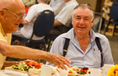 Seniors enjoy a hot lunch at the College Avenue Center. Courtesy Jewish Family Service