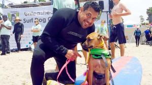 Tony Nila, dog behaviorist, with a surf dog in Imperial Beach. Photo courtesy Tony Nila