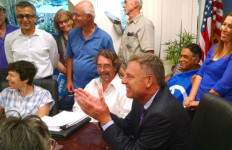 Rep. Scott Peters talks with protesters in the conference room of his San Diego office. Photo by Chris Jennewein