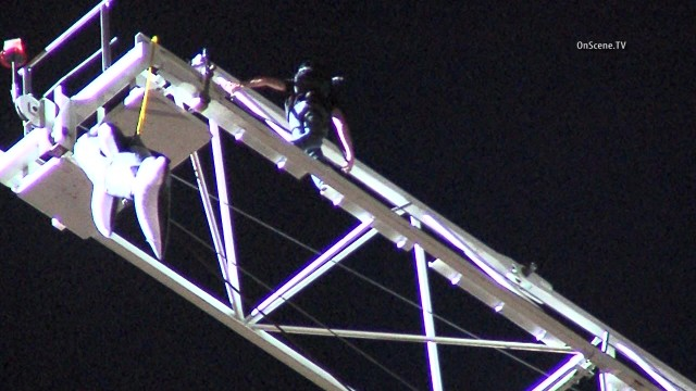 Steve-O on the crane in Hollywood with the inflatable Shamu hanging at left. Courtesy of OnScene.TV