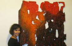 Artist Becky Guttin with one of her works on display at the Low Gallery.