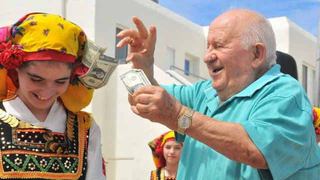 Notis Tavlaridis showers his granddaughter with money at the Annual Cardiff Greek Festival. Photo by Chris Stone