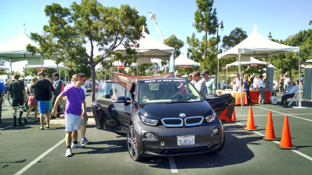 Visitors at Electric Car Day examining a BMW i3 electric. Photo by Chris Jennewein