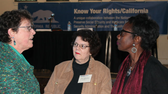Ellen Morgenstern (center) speaks with attendees at a Know Your Rights town hall meeting.