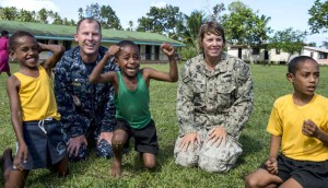 Capt. Christopher Engdahl with a Navy crew member and children in Fiji. Photo courtesy Navy Live Blog