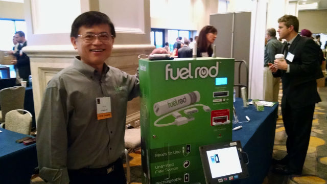 Chi Yau with a Fuel Rod kiosk for exchanging cell phone batteries. Photo by Chris Jennewein