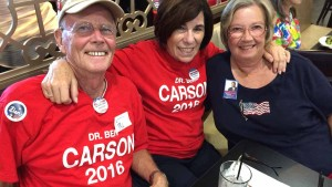 Phil Feeney of Oceanside, Margie Wilhelm of San Marcos and Judy Gast of Ramona showed their Ben Carson colors at GOP debate watch party. Photo by Ken Stone