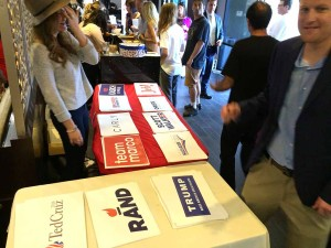 Republicans attending the GOP debate watch party had their pick of placards. Photo by Ken Stone