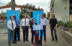Jill Szuchmacher of Google Fiber with Mayor Kevin Faulconer at her right in Barrio Logan. Photo by Chris Jennewein