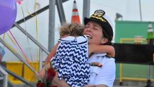 Dr. Marion Henry shows the emotion of reuniting with her daughter, Katie, 4. Photo by Chris Stone
