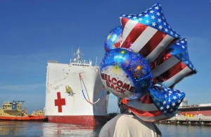 Justin Avery waits with balloons for his sister to depart the USNS Mercy. Photo by Chris Stone