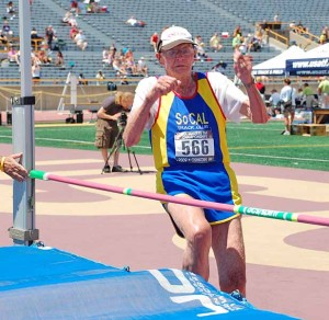 Leland McPhie, as a 95-year-old member of the SoCal Track Club, jumps at a national masters championship in 2009 in Oshkosh, Wisconsin. Photo by Chris Stone