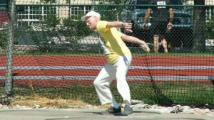 At 90, Don Pellmann throws the discus during seven-record day in 2005. Photo courtesy Ned Pellmann