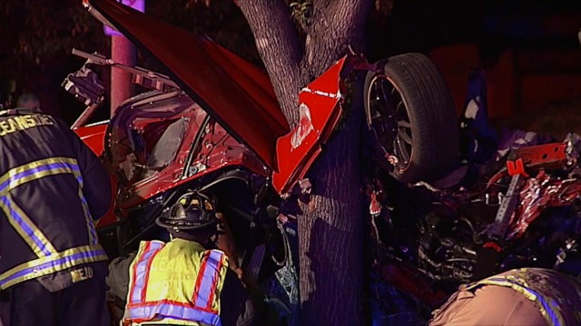 Firefighters at the scene of the first rollover crash. Courtesy of OnScene.TV