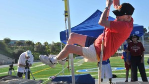 Pellman reaches to clear a height in the pole vault at the Senior Olympics meet at Mesa College. Photo by Chris Stone