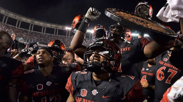 The San Diego State football team celebrates after it's win over University of San Diego in 2015. Courtesy of GoAztecs Facebook.