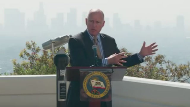 Jerry Brown at Griffith Observatory with the Los Angeles skyline barely visible through the smog. Photo from official video feed