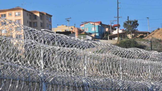 New barbed wire has been added to the border fence in the last month. Photo by Chris Stone