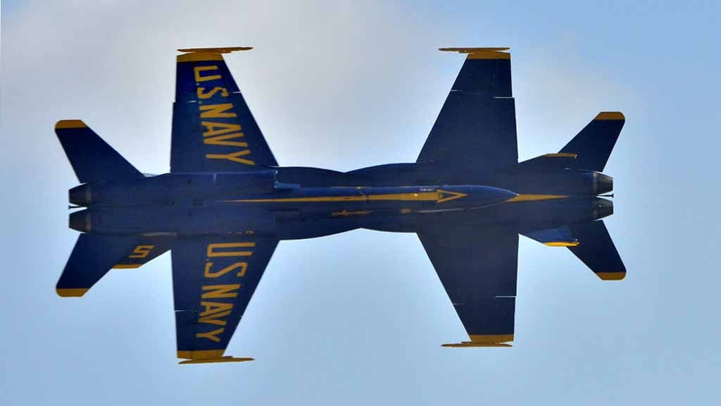 Two Blue Angel jets seem as one as the make a close pass in the Miramar Air Show Saturday. Photo by Chris Stone