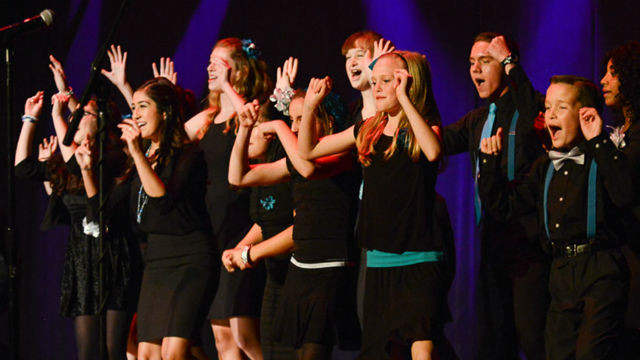 The Moonlight Youth Theatre choir performs at Copley Symphony Hall in June. Courtesy Moonlight Cultural Foundation