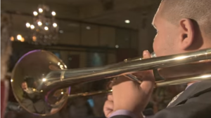 Terrence Patridge playing the trombone. Screenshot from Base Cleff Bliss trailer.