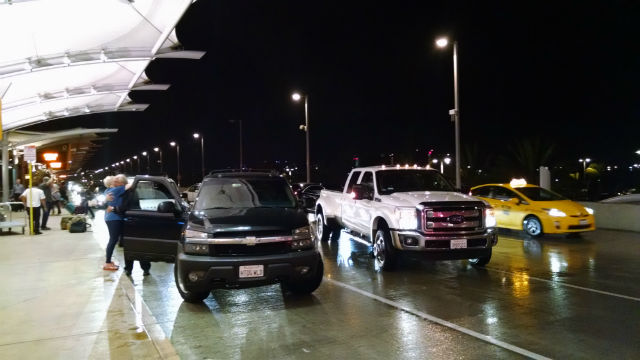 Travelers arrive at San Diego International Airport in light rain. Photo by Chris Jennewein