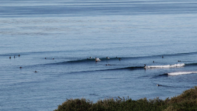 Surfers at the break point off Swami's Beach in Encinitas. Photo by Mikefairbanks via Wikimedia Commons