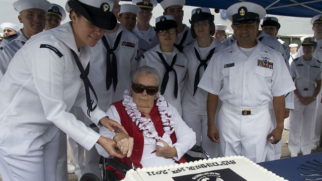 Sybil Stockdale cutting a cake on POW/MIA Day in 2011. Navy photo