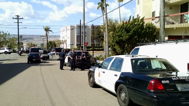 San Diego Police cars and motorcycles block Albatross Street in Bankers Hill. Photo by Chris Jennewein