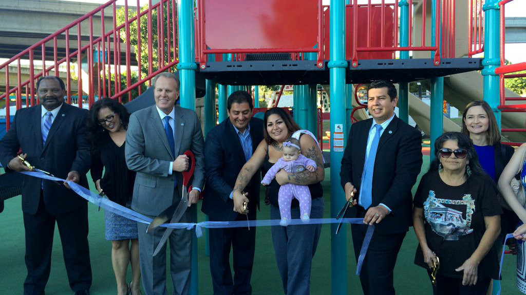 Assemblywoman Lorena Gonzalez, Mayor Kevin Faulconer and Councilman David Alvarez (l) at the ribbon-cutting ceremony for the revamped Chicano Park. Photo courtesy of the Mayor's office