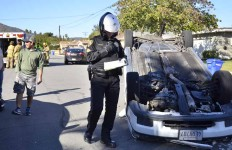 La Mesa police investigate a one-car accident in which a car flipped over on a residential street. Photo by Chris Stone