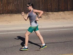 Erin Taylor-Talcott, drenched in sweat, motors along Mast Boulevard in 50K walk. Photo by Calvin Lau