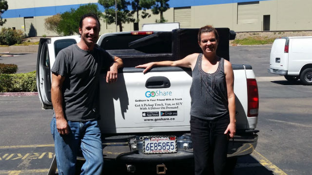A GoShare driver and his truck with a satisfied customer. Courtesy GoShare