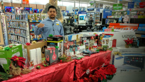 Jesus Villa with some of Walmart's featured items.
