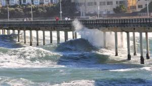 Big waves pound the Ocean Beach Pier Monday. Photo by Chris Stone