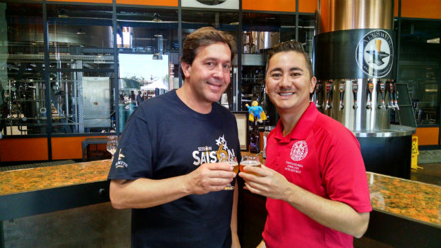 AleSmith CEO Peter Zien (left) toasts the new District 6 beer with City Councilman Chris Cate. Photo by Chris Jennewein