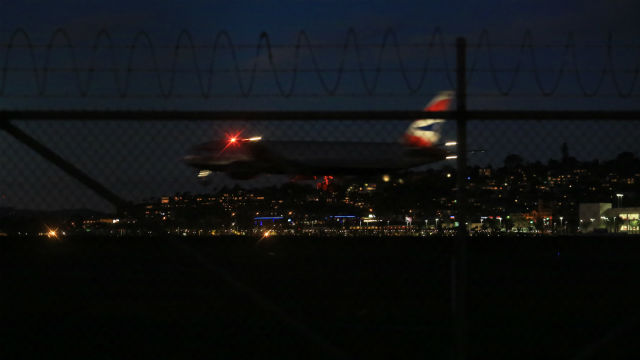 A plane takes off at night from San Diego International Airport. Photo by Megan Wood, inewsource